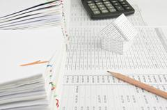 Pencil and house on finance account Stock Photos