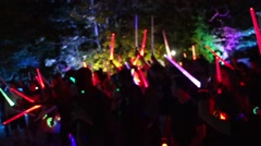 People holding light saber outdoor party at night Stock Footage