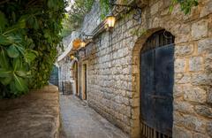 Budva old town street with shine lanterns Stock Photos