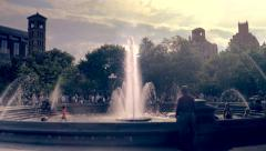 Fountain and people backlit by the sun, Washington Square Park Stock Footage