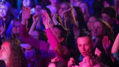 Youth disco. Night club. People dancing with  hands raised. - stock footage