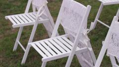 Beautiful white chairs with a light cloth for the wedding ceremony. Wedding day. - stock footage