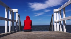 Alone Woman in Red Shirt at the Edge of Pier Stock Footage