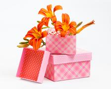 decorative gift boxes with orange lily flowers - stock photo