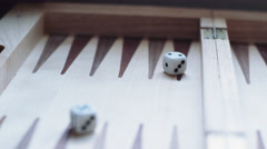 Rolling a pair of dice Stock Footage
