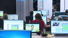 Reporters and editors working in the newsroom of the international tv channel. - stock footage