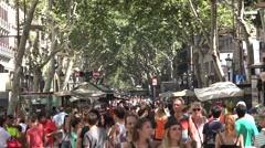 People walking along the las ramblas in barcelona city -spain Stock Footage