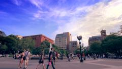 People strolling by the Washington Square Park fountain - stock footage