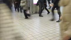 Commuters walking crossing in rush hour at subway transit station Stock Footage