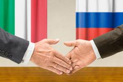 Representatives of Italy and Russia shake hands - stock photo