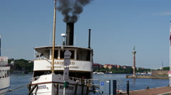 Stock Video Footage of Tilt from cruise ships with steam to the Stockholm City Hall in Sweden