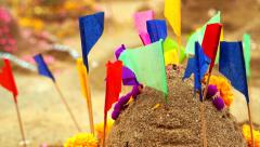 Beautiful decorate sand castle with flags and flower for Thai New Year festival Stock Footage