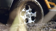 Car's wheels in mud in the forest, off-road. SUV got stuck in the mud and trying - stock footage