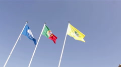Blue Beach, Portuguese and Olhao municipality Flags in the wind Stock Footage
