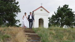 Wedding Couple Descend Stairs Kiss - 4k - Slow Motion Stock Footage