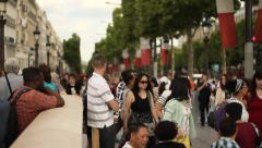 People entering into a metro station in Paris Stock Footage
