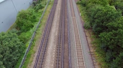 Aerial view of passenger train passing at a London city Stock Footage
