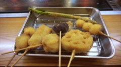 Kushikatsu, Osaka food Japanese dish of seasoned, skewered and deep fried meat Stock Footage