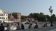 People relaxing at waterfront of Canal Grande - stock footage