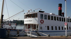 Stock Video Footage of Pan from classic cruise ships with steam in Stockholm Sweden