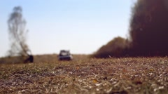 Off road SUV vehicle running in autumn forest on road Stock Footage