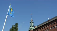 Flag at the Stockholm City Hall in Sweden Stock Footage