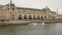 Sightseeing boat passing in front of Orsay museum Stock Footage