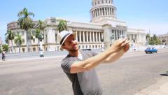 Tourist taking a self photo in Havana, Cuba Stock Footage