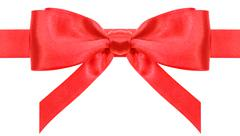 Stock Photo of symmetric red bow with vertically ends on ribbon