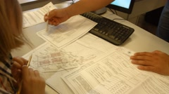 Engeneeres, manager discusion compare data in technical financial documents Stock Footage