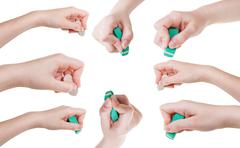 Stock Photo of set of hands with rubber eraser close up isolated