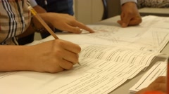 Hand writes into document, adjustments to the document Stock Footage