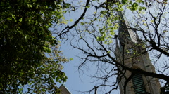 Oscar's Church behind the trees in Stockholm Sweden Stock Footage