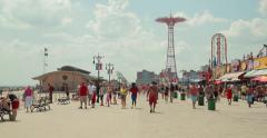 Coney Island beach boardwalk in New York City Stock Footage