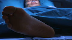 Patient lying in a hospital bed Stock Footage