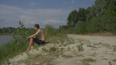 Young man on a beach Stock Footage