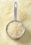 Uncooked Jasmine rice in a saucepan Stock Photos