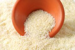 Bowl of uncooked Thai Jasmine rice Stock Photos