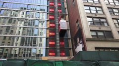 Construction Elevator On Glass Building Stock Footage
