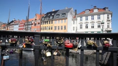Love locks on a bridge in old town Nyhavn Stock Footage