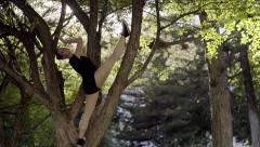 Ballerina Poses In Tree, Demonstrates Flexibility, She Dances Gracefully Stock Footage