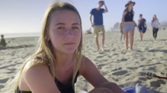 Portrait of young woman on beach Stock Footage
