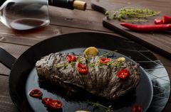 Beef steak with herbs and chilli, product photo - stock photo