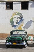 Green Classic Cuban Car and Che painting Stock Photos