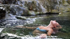 Woman Takes a Bath in Natural Thermal Waters of Hot Springs Spa Stock Footage
