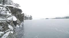 Frozen lake with Rockies Northern Ontario Stock Footage