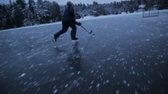 Playing hockey on frozen lake - stock footage