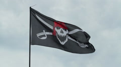 Pirate Flag with skull and cross swords Stock Footage