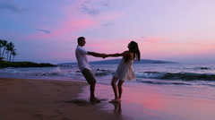 Romantic Couple Playing on Beach - stock footage