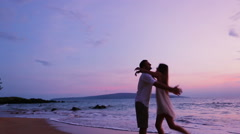 Young Playfull Couple on Beach Stock Footage